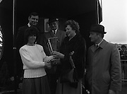 """Powers Gold Cup At Fairyhouse..1986..01.04.1986..04.01.1986..1st April 1986..""""Bartres"""", owned by Mr John Purfield,.won the Powers Gold Cup at Fairyhouse racecourse today.The winning jockey was Mr T Morgan and the horse was trained by Mr Des Hughes. Fairyhouse is in Co Meath near the village of Ratoath...Not an April Fools Joke, Image shows Ms Marie Cummins,Wife of Mr Michael Cummins,Managing Director,Irish Distillers Sales Company, presenting the Gold Cup to Mrs Kay Purfield(centre)..(L-R front)Ms Marie Cummins, Mrs Kay Purfield, Mr Des Hughes,Trainer..(rear) Mr Michael Cummins, Managing Director,Irish Distillers Sales Company and Mr John Purfield,owner."""