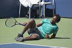 August 30, 2017 - Flushing Meadows, New York, U.S - Gael Monfils slides and takes a rest during his match on  Day Three of the 2017 US Open with Jeremy Chardy at the  USTA Billie Jean King National Tennis Center on  Wednesday August 30, 2017 in the Flushing neighborhood  of the Queens borough of New York City. Monfils defeats  Chardy, 7-6(8-6), 6-3, 6-4. (Credit Image: © Prensa Internacional via ZUMA Wire)