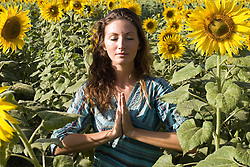 Jul. 26, 2012 - Young woman in field of sunflowers (Credit Image: © Image Source/ZUMAPRESS.com)