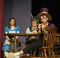 Alice (Olivia Martinson), March Hare (Barron Clugston, and the Mad Hatter (Joseph Kehr) during dress rehearsal for Alice in Wonderland at the Winnisquam Regional High School Wednesday evening.  (Karen Bobotas/for the Laconia Daily Sun)