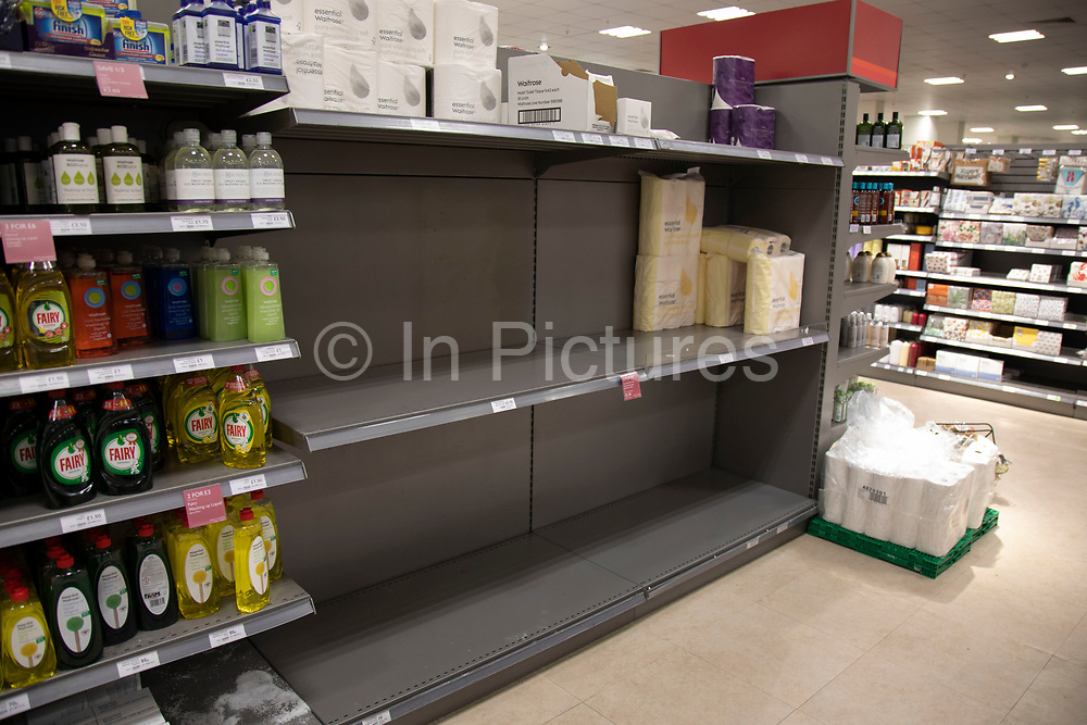 Empty supermarket shelves due to panic buying of essential goods during the coronavirus outbreak on 7th March 2020 in London, United Kingdom. Some customers have started shopping in bulk for certain items to stockpile as the virus continues to spread and the number of cases increases, amid concerns for public health. Here, very few toilet rolls remain on sale.