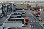April 8, 2020, Hounslow, England, United Kingdom: Planes and trucks are seen at Heathrow Airport Cargo station on Wednesday, April 8, 2020 - as it called on more airlines and freight companies to maximise the use of the hub's quieter flight schedule in the fight against COVID-19. Logistics companies have already begun importing key equipment such as COVID-19 testing kits via Heathrow in preparation for increased demand. Heathrow's cargo movements are forecast to increase by 53%, as more airlines and freighter operators use the available capacity to transport goods which will assist in the fight against coronavirus. (Credit Image: © Vedat Xhymshiti/ZUMA Wire)