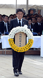NAGASAKI, Aug. 9, 2016 (Xinhua) -- Japanese Prime Minister Shinzo Abe presents a wreath to atomic bombing victims during a ceremony commemorating the 71st anniversary of U.S. atomic bombing at the Peace Park in Nagasaki, on Aug. 9, 2016. To accelerate Japan's surrender in the World War II, the U.S. forces dropped two atomic bombs on Hiroshima and Nagasaki respectively on Aug. 6 and 9, 1945.  (Xinhua/Ma Ping) (syq) (Credit Image: © Ma Ping/Xinhua via ZUMA Wire)