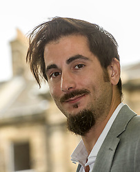Pictured: André Naffis-Sahely is a poet, critic and translator. He was born in Venice to Italian and Iranian parents, and grew up in Abu Dhabi. He has a BA in History and Politics and an M.Litt in Creative Writing from the University of St Andrews.<br /> Book fanatics headed to Charlotte Square in Edinburgh which is the hub of the international Book Festival to meet the authors and also to meet up with fellow fans of the printed word.<br /> <br /> <br /> Ger Harley | EEm 21 August 2017
