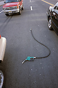 Broken gas pump hose in the street