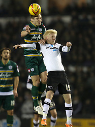 Queen Park Rangers' Kevin Doyle wins an aerial duel with Derby County's Will Hughes - Photo mandatory by-line: Matt Bunn/JMP - Tel: Mobile: 07966 386802 10/02/2014 - SPORT - FOOTBALL - Derby - Pride Park - Derby County v QPR - Sky Bet Championship