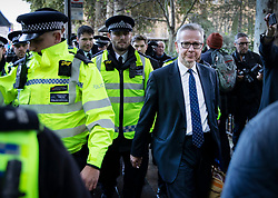 CAPTION CORRECTION RO MISSPELLING OF MICHAEL GOVE © Licensed to London News Pictures. 19/10/2019. London, UK. Michael Gove is escorted by police as he leaves Parliament after MPs voted for a Brexit deal delay. The Prime Minister's new Brexit deal is being debated and voted on in an historic Saturday sitting in The House of commons today. Photo credit: Peter Macdiarmid/LNP