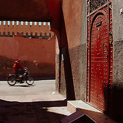 A red door at a narrow street of the medina of Marrakech