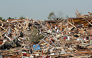 Residents try to salvage belongings from their tornado-destroyed houses in Oklahoma City, Oklahoma May 22, 2013.  Rescue workers with sniffer dogs picked through the ruins on Wednesday to ensure no survivors remained buried after a deadly tornado left thousands homeless and trying to salvage what was left of their belongings.  REUTERS/Rick Wilking (UNITED STATES)