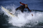 Young man surfing short board in San Diego.