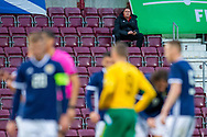 Scottish Football Association performance director Malky Mackay sits in an empty stand, and watches the U21 UEFA EUROPEAN CHAMPIONSHIPS match between U21 Scotland and U21 Lithuania at Tynecastle Park, Edinburgh, Scotland on 10 October 2019.