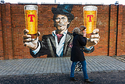 Tennent's lager mural painted on wall at Tennent Caledonian Breweries  Wellpark Brewery in Glasgow, Scotland, UK