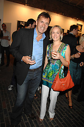 DUNCAN BANNATYNE and CLAIRE DOBSON at the launch of 'Glenmorangie 5 Senses' an exhibition of photographs by Mike Figgis held at Proud Camden, Stables Market, London NW1 on 13th May 2008.<br /><br />NON EXCLUSIVE - WORLD RIGHTS