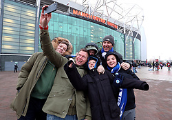 Brighton and Hove Albion fans pose for a selfie ahead of the Emirates FA Cup, quarter final match at Old Trafford, Manchester.