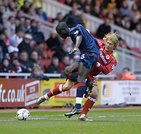 Photo. Glyn Thomas.<br /> Middlesbrough v Portsmouth. FA Barclaycard Premiership.<br /> Riverside Stadium, Middlesbrough. 06/12/2003.<br /> Boro's Gaizka Mendieta (R) battles for possession with Amdy Faye.