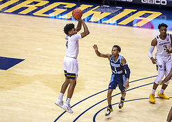 Dec 1, 2019; Morgantown, WV, USA; West Virginia Mountaineers guard Miles McBride (4) shoots during the first half against the Rhode Island Rams at WVU Coliseum. Mandatory Credit: Ben Queen-USA TODAY Sports