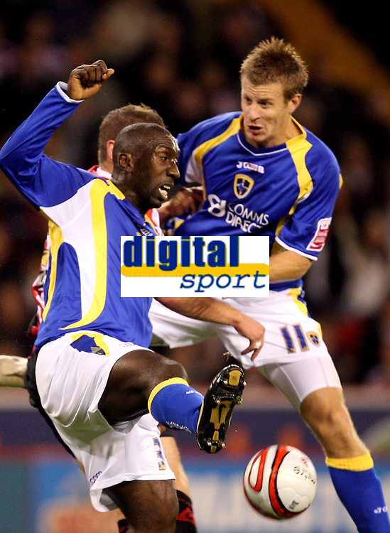 Photo: Paul Greenwood.<br />Sheffield United v Cardiff City. Coca Cola Championship. 02/10/2007.<br />Cardiff's Jimmy Floyd Hasselbaink, and Paul Parry attack the ball in the air