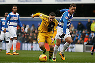 Ross McCormack © of Fulham evading a challenge from Daniel Tozser of QPR.  Skybet football league championship match, Queens Park Rangers v Fulham at Loftus Road Stadium in London on Saturday 13th February 2016.<br /> pic by Steffan Bowen, Andrew Orchard sports photography.