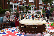 Iced sponge cake with royal family figures at a neighbourhood street party in Dulwich, south London celebrating the Diamond Jubilee of Queen Elizabeth. A few months before the Olympics come to London, a multi-cultural UK is gearing up for a weekend and summer of pomp and patriotic fervour as their monarch celebrates 60 years on the throne and across Britain, flags and Union Jack bunting adorn towns and villages.