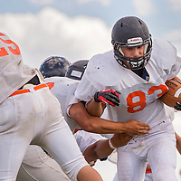 081413       Cable Hoover<br /> <br /> Xavier Hoover tries to push past his teammates during Gallup Bengals football practice Wednesday at Gallup High School.
