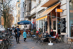 Cafes and shops on Hufelandstrasse in gentrified district of Prenzlauer Berg in Berlin  Germany