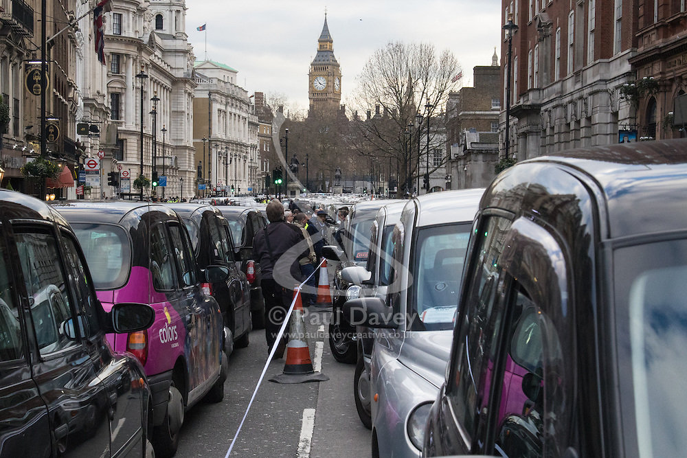 Whitehall, London, February 10th 2016. Hundreds of taxis blockade Whitehall, with Big Ben in the background as an estimated 8,000 cabbies hold a go-slow in protest against what they say is unfair competition from minicab and Uber drivers who do not have to undergo the rigorous training and checks required for the licenced taxi trade. ///FOR LICENCING CONTACT: paul@pauldaveycreative.co.uk TEL:+44 (0) 7966 016 296 or +44 (0) 20 8969 6875. ©2015 Paul R Davey. All rights reserved.
