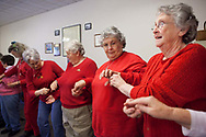 Sharon Boyer grabs a Hershey's Kiss chocolate from Betty Speelman (right) and passes another to Pauline Dailey during a Valentine's Day game at Lottridge Community Center in Lottridge, Ohio, Feb. 14, 2012. Widowed or single women like Boyer, Speelman and Dailey regularly outnumber men at the community center, which hosts senior citizens every Tuesday afternoon for lunch and activities.