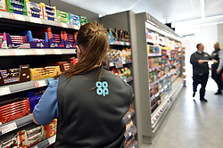 Stacking shelves in co-op food store UK