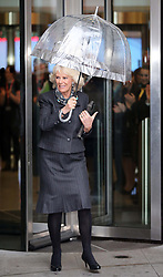 The Duchess of Cornwall  shelters from the rain with an umbrella after visiting the BBC at New Broadcasting House in London, Tuesday, 11th February 2014. Picture by Stephen Lock / i-Images
