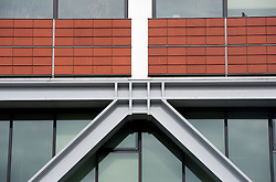 Detail of modern complex structural steel connection on external facade of office building in The Hague Netherlands
