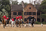 Huntsman Jamie Green leads the hounds in the first fox hunt of the season at Middleton Place Plantation December 1, 2013 in Charleston, SC.