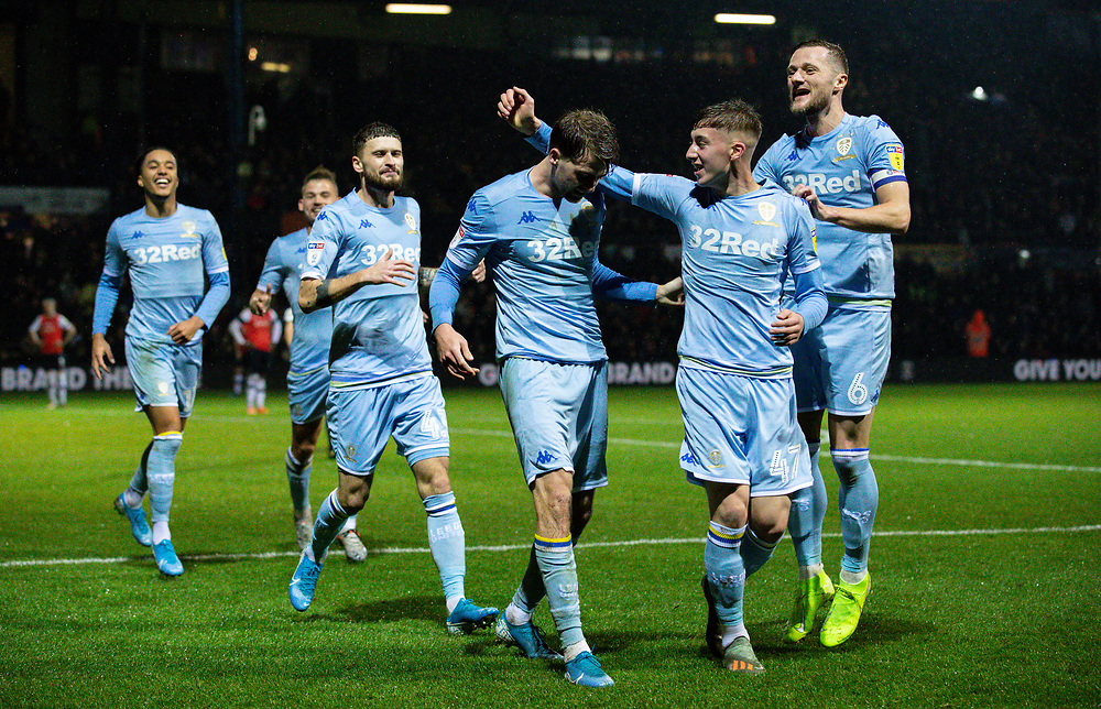 Leeds United's Patrick Bamford celebrates with team-mates after his side got a late winner courtesy of a Matty Pearson own goal<br /> <br /> Photographer Alex Dodd/CameraSport<br /> <br /> The EFL Sky Bet Championship - 191123 Luton Town v Leeds United - Saturday 23rd November 2019 - Kenilworth Road - Luton<br /> <br /> World Copyright © 2019 CameraSport. All rights reserved. 43 Linden Ave. Countesthorpe. Leicester. England. LE8 5PG - Tel: +44 (0) 116 277 4147 - admin@camerasport.com - www.camerasport.com