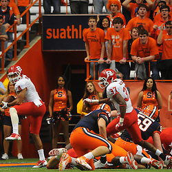 Rutgers safety David Rowe (4) intercepts a Syracuse pass on his defensive goal line en route to Rutgers victory over Syracuse in Big East NCAA college football 19-16 in double overtime at the Carrier Dome in Syracuse, NY on Oct. 1, 2011.