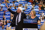 Jane and Bernie Sanders wave to the crowd of more than 6,600 at Penn State's Rec Hall after a campaign rally on April 19, 2016.