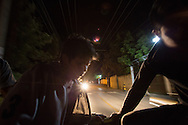 Antonio Cruz Sanchez, 26, Abigail Quic and ten other people share the back of a pick-up truck into Antigua to celebrate Abi's birthday. It's a common, cheap means of transportation in Guatemala. San Juan Del Obispo, Gatemala, July 23, 2014