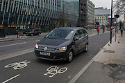 A hire car strays into the two-way cycling lanes on 9th February 2017, on Blackfriars Bridge Road, in London borough of Southwark, England.