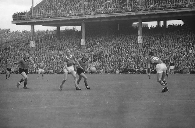 Kerry's M.O'Connell and Down's P. Rooney tussle for possession in mid field during the All Ireland Senior Gaelic Football Final Kerry v Down in Croke Park on the 22nd September 1968. Down 2-12 Kerry 1-13.