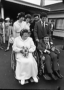 Historic Wedding Bells For Disabled Couple,  (N81)..1981..20.06.1981..06.20.1981..20th June 1981..Happy wedding bells chimed today for the first disabled couple in residential care to marry in the Republic of Ireland. The happy couple are Marie Skully and Pat Linehan and they were married in a special ceremony in The Cara Cheshire Home in the Phoenix Park. Both Marie and Pat are confined to wheelchairs because of their disabilities. After honeymoon, they will make their home in specially adapted quarters within the Cheshire residence...The happy couple pose for pictures with the bridesmaids and groomsmen.