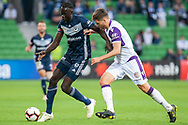Melbourne Victory forward Kenny Athiu (7) defends the ball at the Hyundai A-League Round 2 soccer match between Melbourne Victory and Perth Glory at AAMI Park in Melbourne.