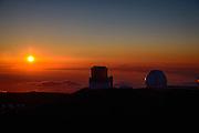 The Kech I and Suzuki telescopes stand watch as the sun falls below the horizon atop Mona Kea, Big Island of Hawaii.