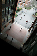 Students walk underneath the Suzzallo-Allen Library on the University of Washington campus in Seattle, Washington.
