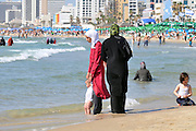Israel, Tel Aviv, an Arab family enjoy a fun day at the beach