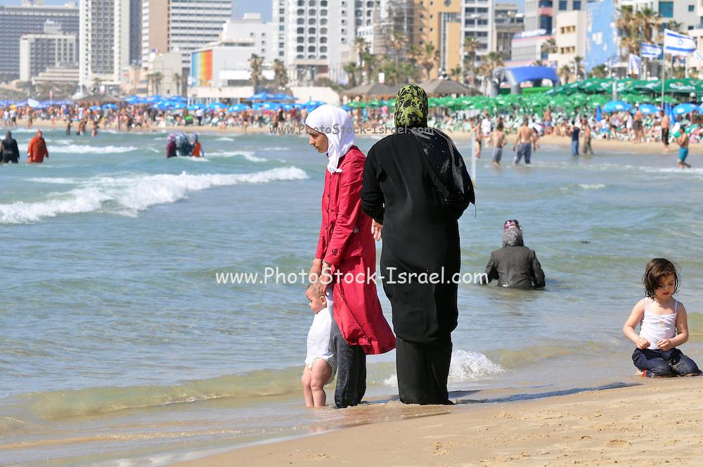 Israel, Tel Aviv, an Arab family enjoy a fun day at the beach