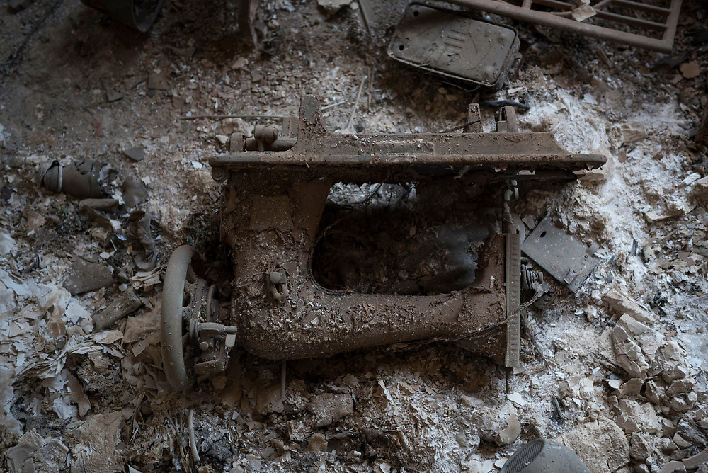 A sewing machine lies on the floor of a burned home in the predominately Christian town of Qaraqosh, Iraq. Homes, churches, and businesses in the town was heavily damaged during the ISIS occupation from 2014 to 2016. (May 20, 2017)