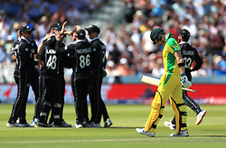 New Zealand team celebrate the wicket of Australia's Steve Smith (right) during the ICC Cricket World Cup group stage match at Lord's, London.
