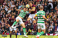 Christophe Berra of Hearts goes up for a header with Celtic's  Tom Rogic during the William Hill Scottish Cup Final match between Heart of Midlothian and Celtic at Hampden Park, Glasgow, United Kingdom on 25 May 2019.