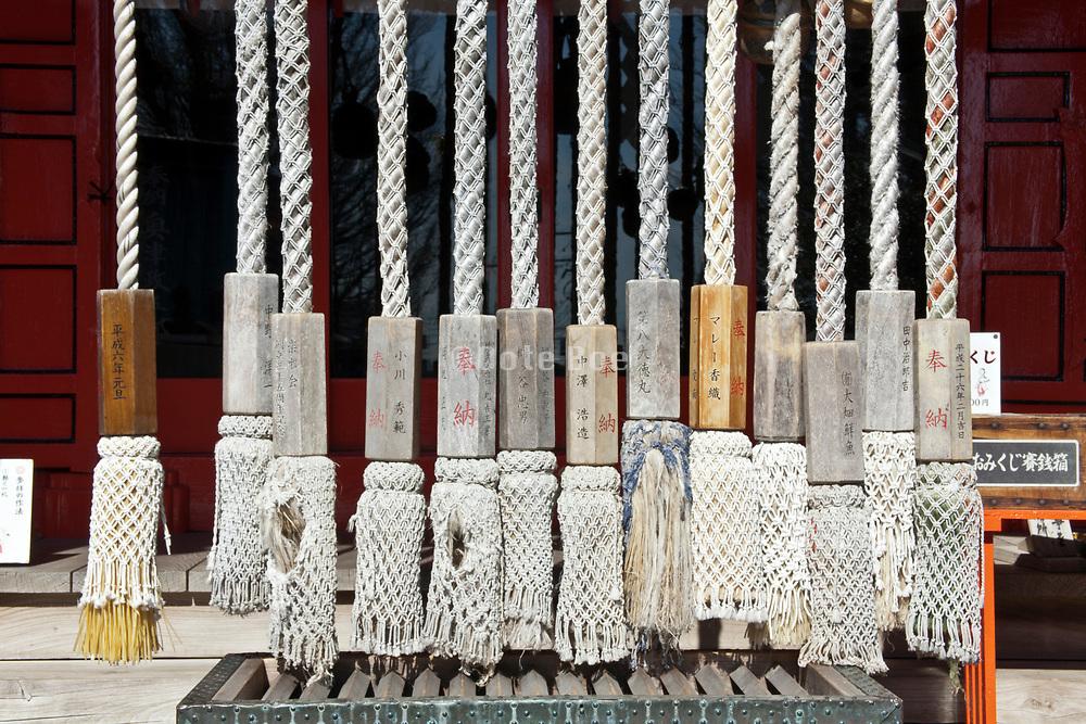 many bell ropes at the Kainan shrine in Misaki  Kanagawa Prefecture Japan