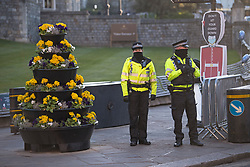© Licensed to London News Pictures. 17/04/2021. Windsor, UK. Police watch over in the early morning outside Windsor Castle in Windsor, Berkshire, ahead of the funeral of Prince Philip, The Duke of York. Prince Philip, the Consort of the longest reigning English monarch in history, Queen Elizabeth II, died on 9 April 2021, two months before his 100th birthday. . Photo credit: Ben Cawthra/LNP