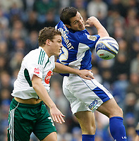 Photo: Steve Bond/Richard Lane Photography. Leicester City v Plymouth Albion. Coca Cola Championship. 21/11/2009. Shane Lowry (L) stretches for the ball as Yann Kermorgant (R) jumps for it
