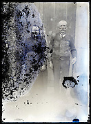 eroding glass plate photo of elderly couple